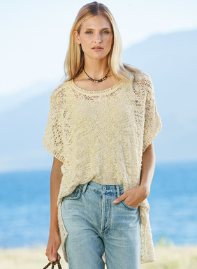 Fabulous as a beach coverup or layered over a cami and jeans, our ethereal lace top is knit of textural cotton flamé yarns. The poncho-inspired silhouette is easy and oversized, with drop shoulders, side slits and rolled edges.