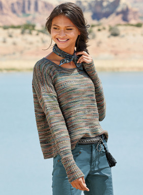 An intriguing color study, the pullover is knit in textural tuckstitches of handpainted cotton yarns. Adorably cropped and boxy, with drop shoulders, slim sleeves and exaggerated ribbed cuffs.