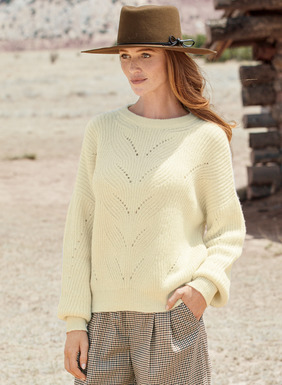 Snuggly soft in Cream baby alpaca, the pullover showcases Art Deco cables and open pointelle detail. Relaxed and easy, with drop shoulders, blouson sleeves and ribbed trim.