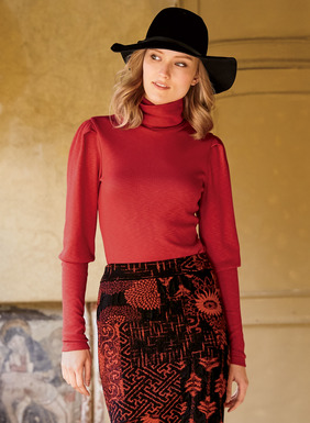 Puffed shoulders and exaggerated cuffs add allure to our season-spanning t-neck. Knit in a soft, ribbed flamé of cotton (47%), modal (47%) and spandex (6%).