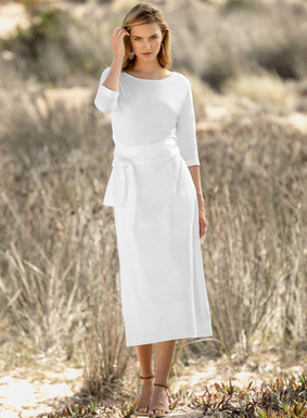 Crisp and cool for warm, sunny days, our travel-friendly dress is sewn of softest pima interlock and styled with dolman elbow-sleeves and a faux-wrap skirt. The attached woven sash ties in front for a flattering, waist-defining shape.