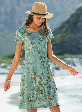 Sprays of pale yellow roses climb a blue sky on our carefree t-shirt dress. In packable pima jersey, our bestselling fit-and-flare silhouette has a round neck and capped sleeves.