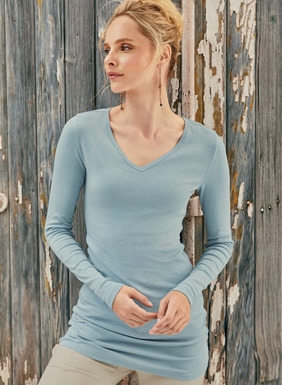 The rib knit v-neck tee is cut long and lean to pull down as a tunic or scrunch up as you prefer. Knit of a soft, substantial blend of pima (98%) and Lycra® (2%).