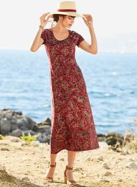 Stylized florals from a Javanese batik textile vine across the rich madder ground of our cotton (92%) and Lycra (8%) jersey t-shirt dress. One-step dressing for work, play or travel, with a scoop neck and A-line hem.
