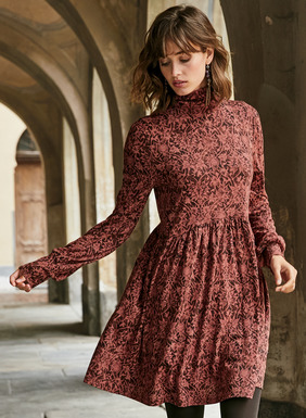 Cast in tonal hues of rose and burgundy, vining botanicals form an elaborate scrollwork on our free-spirited tunic-dress. Sewn of drapy pima (51%) and modal (49%) jersey, with a scrunchable t-neck, billowy gathered sleeves and a curving waist seam that flows to a gathered skirt.