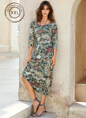 Asian birds and blooms are traced on the dappled blue ground of our cotton (92%) and Lycra (8%) jersey t-shirt dress. An elegant, packable solution for work and travel, with a scoop neck, ¾-sleeves and A-line hem.