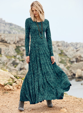 Borrowed from a 15th century Indian block print, night-blooming botanicals in moody shades of jade green and deep blue twine our dramatic jersey maxi-dress. Fits through the bodice, flaring from the waist seam to a full, ankle-length hem. Pima (51%) and modal (49%).
