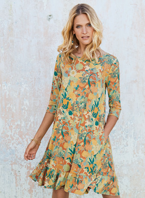 Layered florals of peach, buttercup and jade are splashed on the melon ground of this effortless, pima t-shirt dress. Styled with elbow-sleeves and pockets, the easy silhouette falls to a swingy, ruffled hem.