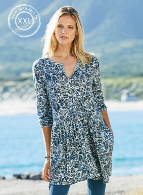 Arabesque florals are traced in blue on the pale grey ground of our pima (51%) and modal (49%) jersey tunic. Buttoning bodice; ¾-sleeves; drop waist; pockets.