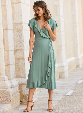 Softy ruffled borders add ultra-feminine allure to the faux-wrap Julep-hued jersey dress. Sewn of drapy pima (46%), modal (46%) and spandex (8%), the universally flattering fit-and-flare silhouette features a crossover v-neck, fluttering sleeves, side tie and curved hem.