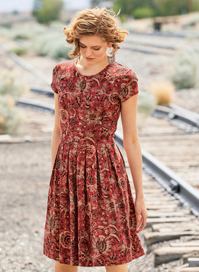 Ideal summer into fall, our carefree cotton (96%) and Lycra (4%) jersey dress is patterned in delicate florals from an antique French textile. Styled with a slim waist and pleated skirt with pockets; back zipper.