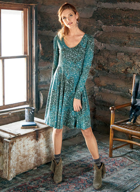 An adorable silhouette in a muted teal potpourri of block-printed florals. Sewn of drapy pima (51%) and modal (49%) jersey, it fits through the bodice, releasing to a twirlable hem.