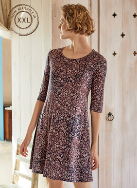 For lounging or laid-back Saturdays, our easy tunic-dress is patterned in woodblock florals. Oatmeal on a weathered plum and navy ground. Pima (51%) and modal (49%) jersey, with a scoop neck, elbow-length sleeves and A-line hem.