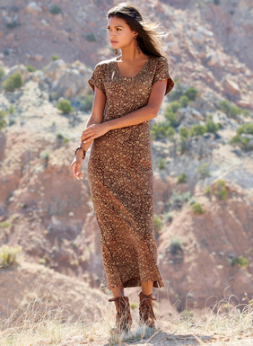 Block print-inspired golden botanicals are sprinkled across the weathered, spice red ground of our effortless jersey dress. A fabulous transition piece for summer into fall in pima (45%), modal (45%) and Lycra (10%). Styled with a v-neck, cuffed cap sleeves and easy silhouette.
