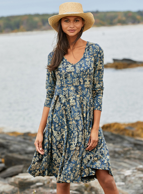 A romantic silhouette is stamped with stenciled Indian block prints on a washed indigo ground. Sewn of drapy pima (51%) and modal (49%) jersey, our v-neck dress fits through the bodice, releasing to a twirlable hem.