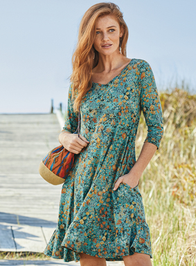 Petite florals of peach, orange, cream and hunter green are strewn across the teal ground of this effortless pima t-shirt dress. Detailed with elbow-sleeves and pockets, the easy silhouette floats to a ruffled hem.