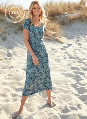 This versatile t-shirt dress is etched  in chrysanthemums in weathered shades of denim and chambray. In drapy pima (45%), modal (45%) and Lycra (10%) jersey with a scoop neck and A-line hem.