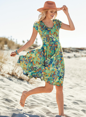 Kaleidoscopic florals of turquoise, terra cotta, periwinkle and citron form a vibrant collage on this fit-and-flare jersey dress. Sewn of drapy pima (51%) and modal (49%), with a v-neck and defined waist that flows to a swingy circular hem.