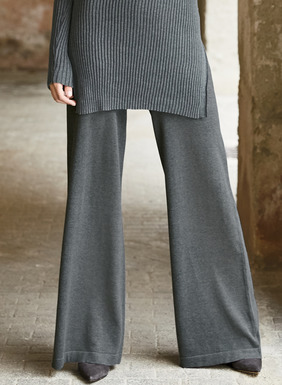 Easy knit dressing, striking the perfect balance between style and comfort. The wide-leg trousers feature a wide elastic waistband and clean-finished hem.