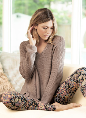 The pullover is laid-back and luxurious in a chunky reverse jersey knit of lofty pima yarns. Wide v-neck; drop shoulders; stepped hem with side slits.