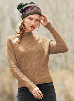 Knit in a fluffy yarn of baby alpaca (60%), polyamide (35%) and wool (5%), the boatneck pullover features dolman sleeves and ribbed cuffs.