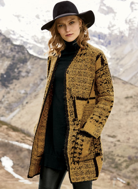 Frothy and light, the knit coat is a tweedy patchwork in rich ochre and black. Jacquard knit of textural alpaca (94%) and polyamide (6%) bouclé yarns, with drop shoulders, buttonless placket and patch pockets.
