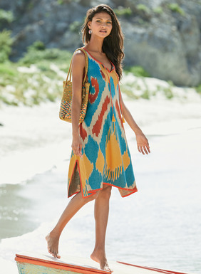 For sun-worshippers, our head-turning tank dress is jacquard knit in bold ikat diamonds of mango, paprika, sand and sky blue pima. The relaxed A-line shape has a split v-neck with tassel ties, pockets and side slits.