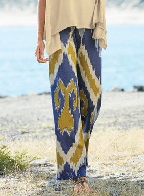 Ikat diamonds in chicory, ultramarine, sand and brass pattern the drapy, wide-legged trousers. Jacquard knit of pima (98%) and spandex (2%), with an elastic waist and pockets.