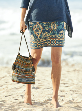 Stylized tulips and geometrics pattern the jacquard knit mini-skirt in aqua, maize and rust on lapis pima.