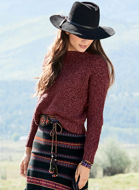 The boxy pullover in a textured tweed of bouclé and mercerized pima yarns has a rolled-edge crewneck, drop shoulders and chunky ribbed trim.