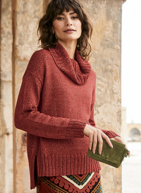 Our boxy pullover is knit of tweeded bittersweet and rust pima. The relaxed silhouette has a cowlneck, drop shoulders, chunky ribbed trim, stepped hem and side vents.