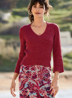 The pullover, in a tweeded mix of berry tones, is full-fashion knit in shapely ribs of pima. A seasonless staple, styled with a deep v-neck and belled ¾-sleeves.