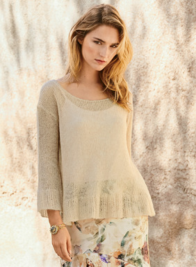 A frothy layer for the balmy days ahead, our sheer, bell-cuffed pullover floats gracefully over dresses or camis. In Crème Brulée baby alpaca (55%), polyamide (24%) and merino wool (21%).