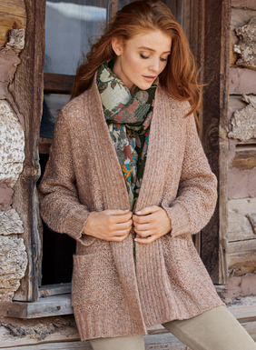 Classically luxurious, our roomy, shawl-collared cardigan is a tactile mix of relaxed tuck stitches and chunky ribbed trim. Frothy and feather-light in tweeded pima (75%), baby alpaca (15%), nylon (9%) and wool (1%), with a buttonless shawl collar, drop shoulders and patch pockets.