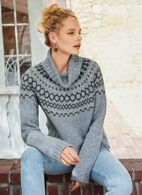 A soft take on traditional folk knitting, our boxy pullover is yoked in a Nordic Fair Isle pattern on an ice blue ground. Warm and light in fluffy baby alpaca (70%), polyamide (23%) and merino wool (7%), with a chunky ribbed cowlneck, raglan sleeves and relaxed ribbed trim.