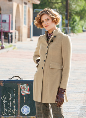 A feminine take on the military riding coat. Impeccably tailored of luxe, soft black baby alpaca (67%), wool (31%) and nylon (2%), the hourglass silhouette has a convertible stand collar, angled lapel, a formation of buttons and a crisply pleated back peplum. Fully lined with our signature lining.