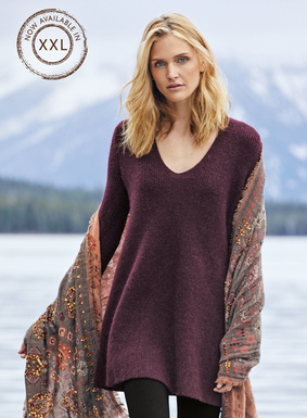 Full-fashion knit of unimaginably soft, woolen-spun royal alpaca, the ribbed tunic is engineered with a deep v-neck, belled sleeves and a swingy hem.