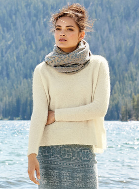 The frothiest sweater of the season is a whipped confection of whisper-light alpaca (81%) and nylon (19%) bouclé yarns. Relaxed and boxy, with drop shoulders, side vents and a hem that steps longer in back.