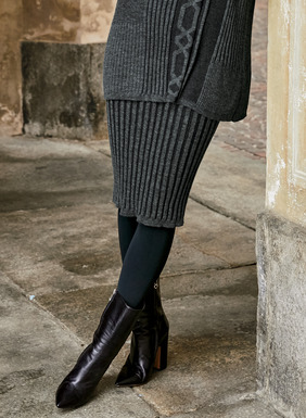 Our fitted pencil skirt is knit in a wide plaited rib of baby alpaca (48%), pima (47%), spandex (3%) and nylon (2%).