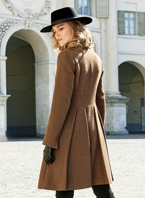 This smartly tailored coat is sewn from a brown and black cavalry twill of wool (46%), alpaca (45%) and nylon (9%). Back pleats sculpt the hourglass silhouette. Notched lapel; shaped seaming; flap pockets; vented cuffs; fully lined  with our signature print.