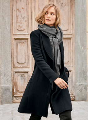 Sleek and chic in the softest pile of baby alpaca (72%), wool (26%) and nylon (2%), this timeless coat is updated with contemporary details. The trim silhouette is tailored with a notched lapel,  vented cuffs and clean zip front with single snap closure. Pockets; back vent.