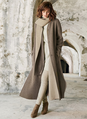 A gorgeous sweep of a coat, this contemporary style may be one of the best outerwear investments ever. Expertly tailored of plush, double-faced alpaca (75%), wool (15%) and nylon (10%), it fully reverses from Taupe Heather to Cream for a completely different look.  Finished with a v-neck, snap closure, extra-deep side vents and pockets, the attached scarf lapel can be worn long and loose or dramatically wrapped as you prefer.