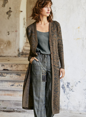Long and lissome, the double-face knit cardigan reverses from batik-print medallions to a delicate tile print in charcoal and tobacco. Year-round useful in feather-light baby alpaca (70%) and silk (30%), with a v-neck, patch pockets and ribbed trim.