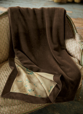 Divinely decadent, our blanket is sublimely soft to the touch in a deep plush pile of suri alpaca (70%), wool (27%) and nylon (3%). Reverses to a smooth satin interior in our signature magnolia print, with mitered self borders. Fabulous for giving (even better, get two and keep one).
