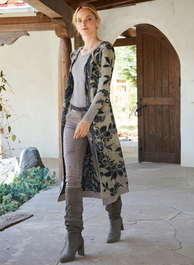 A portrait of cozy chic, the boot-length cardigan reverses from scrolled damask florals to a modern-primitive block print in denim blue and espresso on stone. This elegant sweater-coat is double-faced knit of heavenly soft, pure baby alpaca. Finished with pockets, ribbed trim and a two-button closure at the neck that creates a dramatic, flyaway shape.