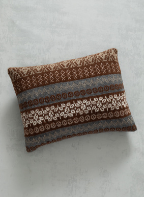 Reimagined from the traditional Scandinavian sweaters, our pillow dresses the bed in patterned Fair Isle stripes. Jacquard knit of soft alpaca (87%) and nylon (13%) in shades of earth and sky, it's finished with a ribknit, buttoning back closure; cushion insert.