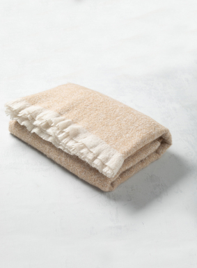 A cloud-soft layer of luxury for the bed, sofa or your favorite reading chair, our Ivory throw is hand-loomed in Peru of soft alpaca (85%), nylon (12%) and wool (3%). Beautifully finished with eyelash fringe on two sides.