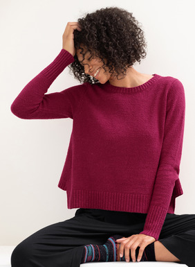 Relaxed and boxy, our sculptural pima (88%) and nylon (12%) bouclé pullover is styled with flared side panels, slim sleeves and chunky ribbed trim at the cuffs and cut-out hem.