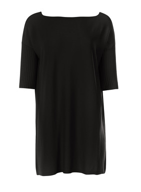 Chic, travel-friendly separates, fine gauge knit in lightweight pima (51%) and modal (49%). The refined knit tunic is simply styled with a bateau neck, drop shoulders and slim, elbow-length sleeves.