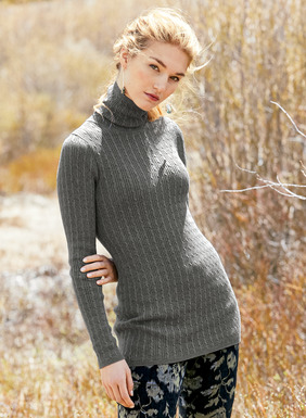 An elevated basic, the soft pima t-neck is full-fashion knit in a mix of ribs and cables.